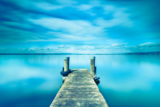 Abstract landscape. Wooden pier on Lake Zug in Switzerland. Long exposure. Abstract landscape. Wooden pier on Lake Zug in Switzerland. Long exposure. zug stock pictures, royalty-free photos & images