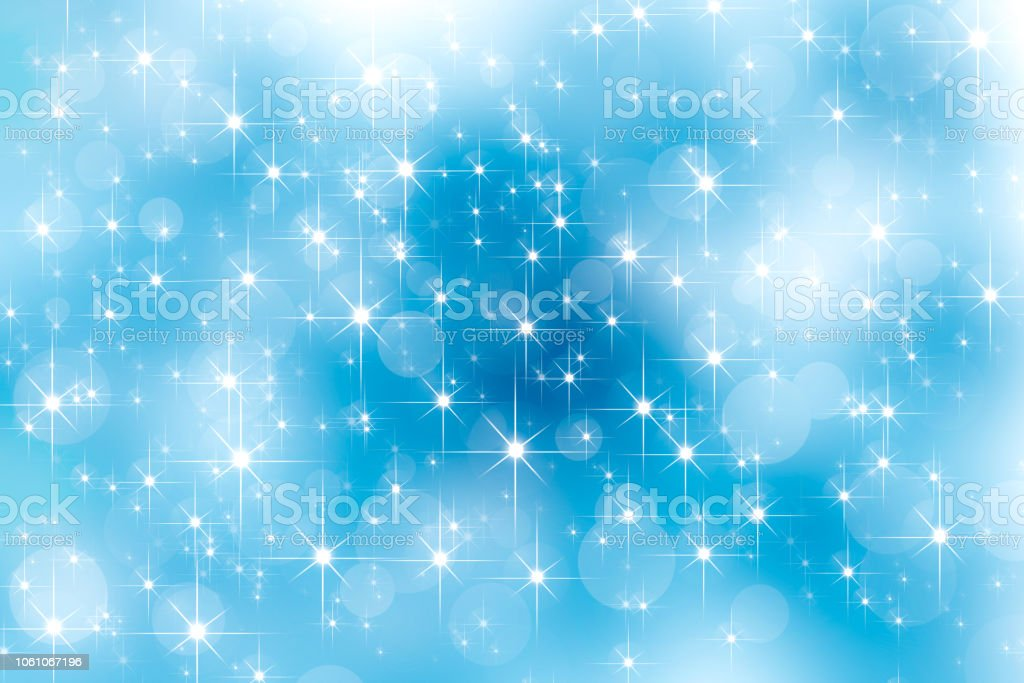 Abstract lens flare shinnig star and bright bokeh effects on blue sky. Glowing lights effect. Christmas new year background. stock photo