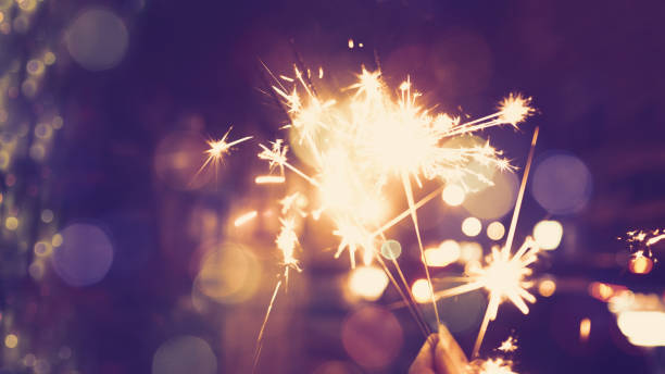 abstract light background - sparkler stock pictures, royalty-free photos & images