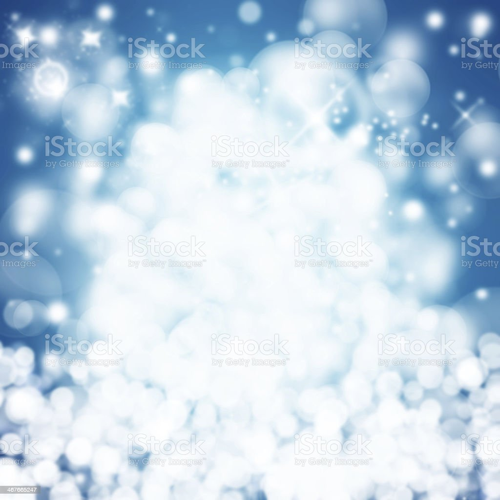 Abstract light blue Christmas background with white lights stock photo