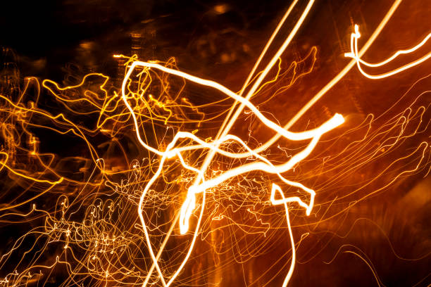 Abstract Light painting with candle light - blurred lights background stock photo