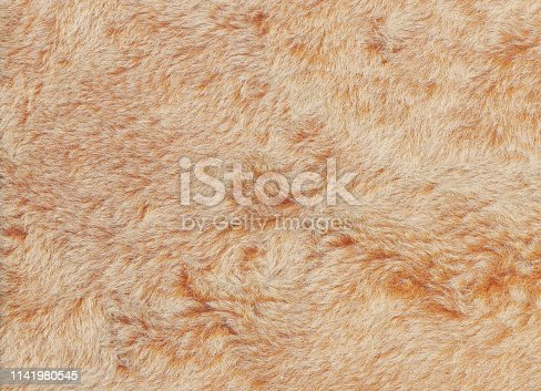 Abstract light red and brown shaggy fluffy fur texture background