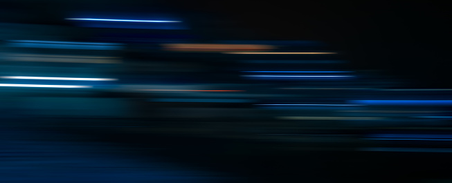 1061376952 istock photo Abstract light trails in the dark background, motion blur 1078966778