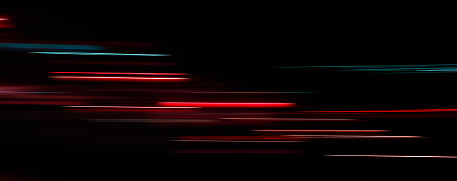1061376952 istock photo Abstract light trails in the dark background 1078966774
