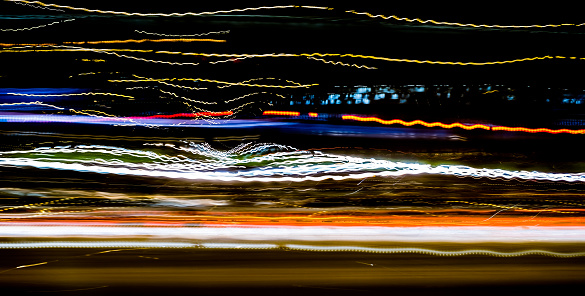 1061376952 istock photo Abstract light trails in the dark 1214859426