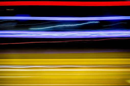 1061376952 istock photo Abstract light trails in the dark 1214859472