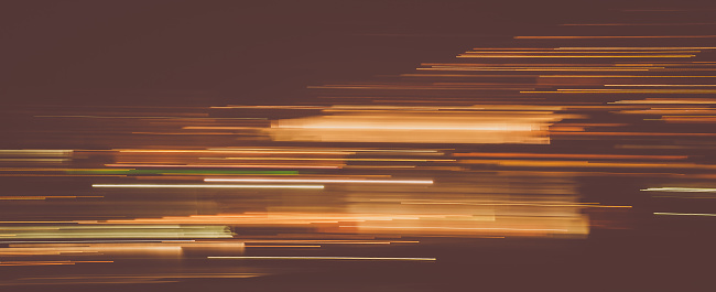 1061376952 istock photo Abstract light trails in the dark, vintage effect 1150260654