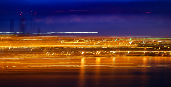 1061376952 istock photo Abstract Light trails on dark background 1191693967