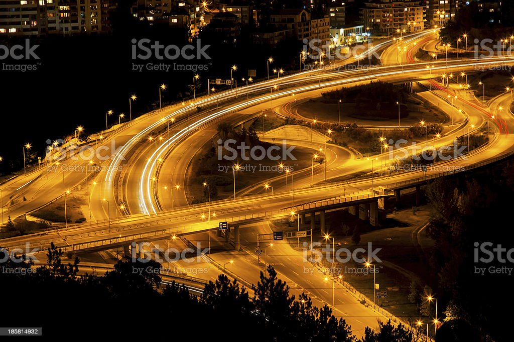 Abstract lights from cars on road junction with bridge royalty-free stock photo