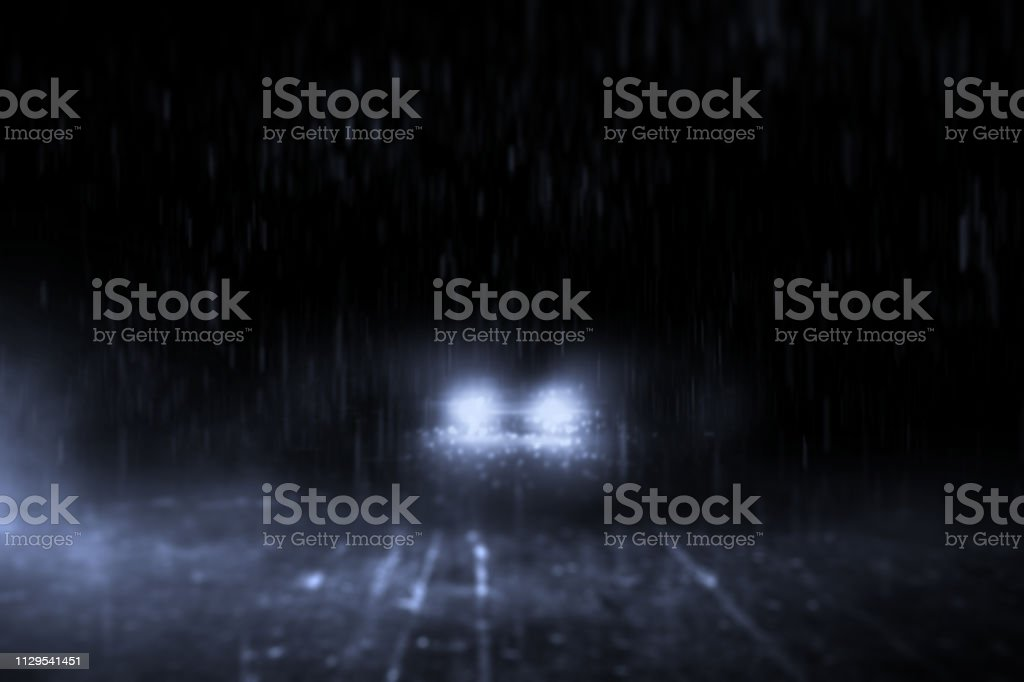 Abstract lonely streets at night, with cars running in the rain