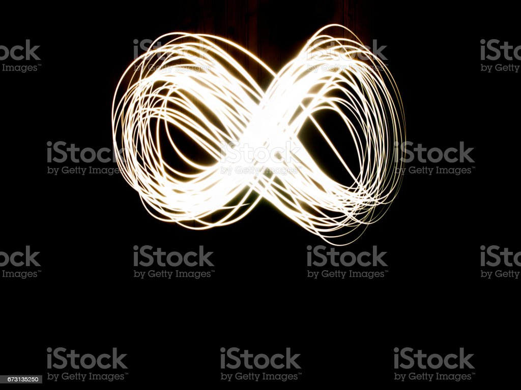 Abstract Long Exposure Of The Infinity Symbol During Night stock photo