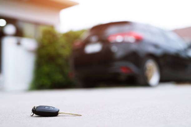 abstract lost car keys fall lying on the street concrete cement ground roadway home front yard. - telecomando background foto e immagini stock