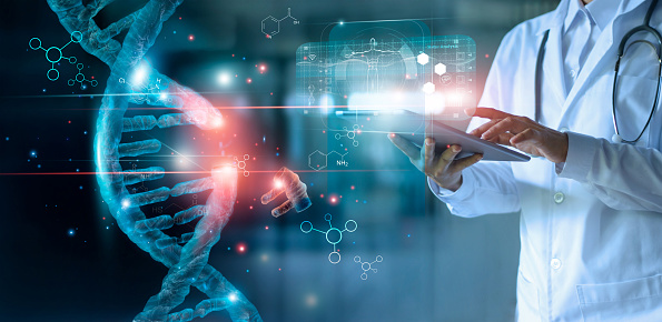 istock Abstract luminous DNA molecule. Doctor using tablet and check with analysis chromosome DNA genetic of human on virtual interface. Medicine. Medical science and biotechnology. 1150397417