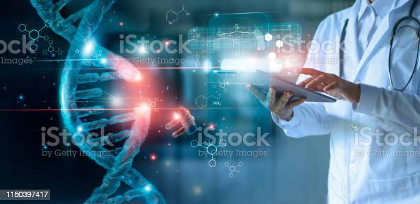 Photo of Abstract luminous DNA molecule. Doctor using tablet and check with analysis chromosome DNA genetic of human on virtual interface. Medicine. Medical science and biotechnology.