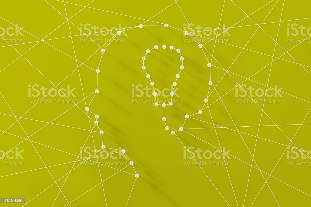 Abstract man and Idea bulb made by strings and pins stock photo