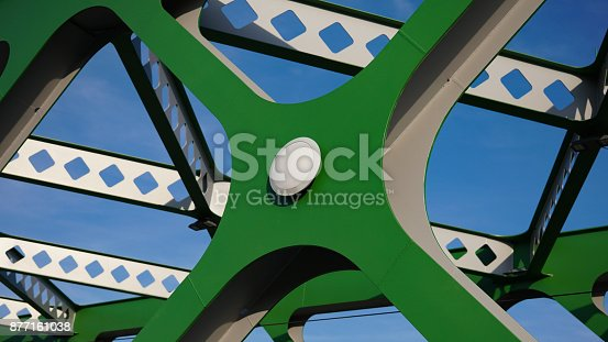 826748544 istock photo Abstract metal construction. Details of the metallic green bridge in Bratislava, Slovakia. Industrial construction. 877161038