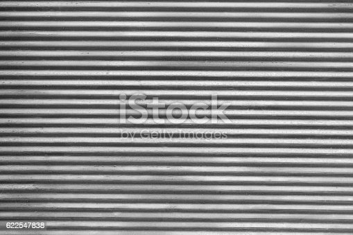 Macro shot of corrugated metallic surface.