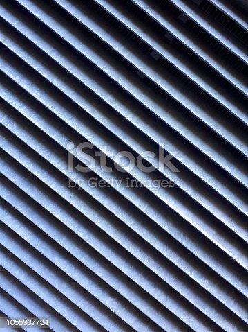 istock Abstract metallic striped pattern 1055937734