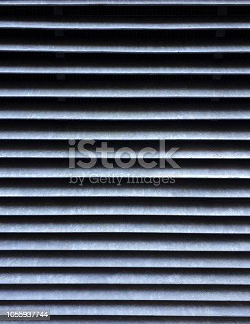 istock Abstract metallic striped pattern 1055937744