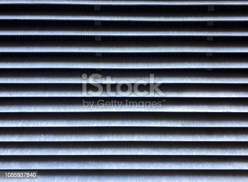 istock Abstract metallic striped pattern 1055937840