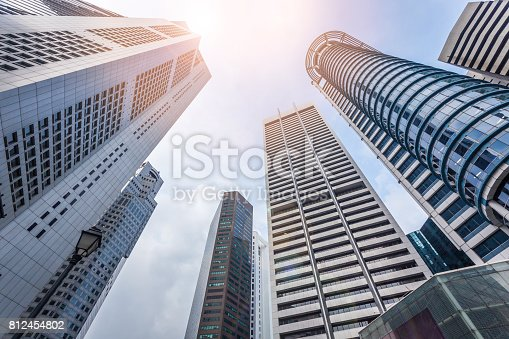 istock abstract modern architecture building on blue sky with sunlight background. 812454802