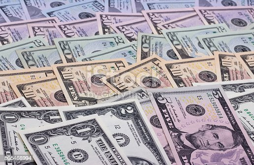 istock abstract money background us dollars of different denominations. 865466994