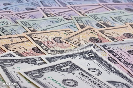 istock abstract money background us dollars of different denominations. 865471042