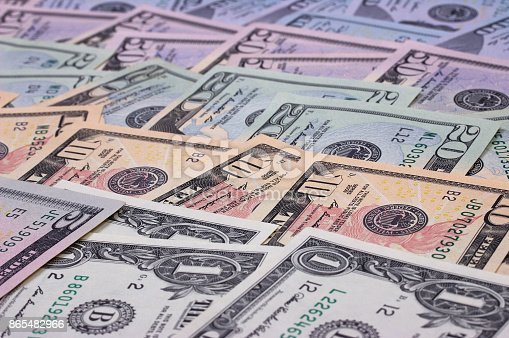 istock abstract money background us dollars of different denominations. 865482966