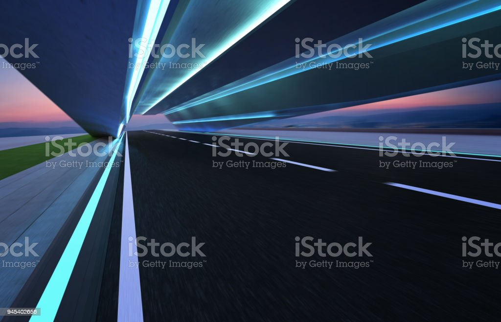 Abstract motion blur effect fast forward moving asphalt tunnel road stock photo