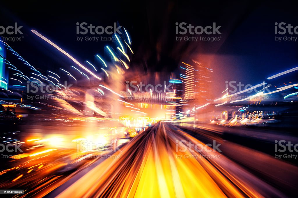 Abstract motion blurred city lights stock photo