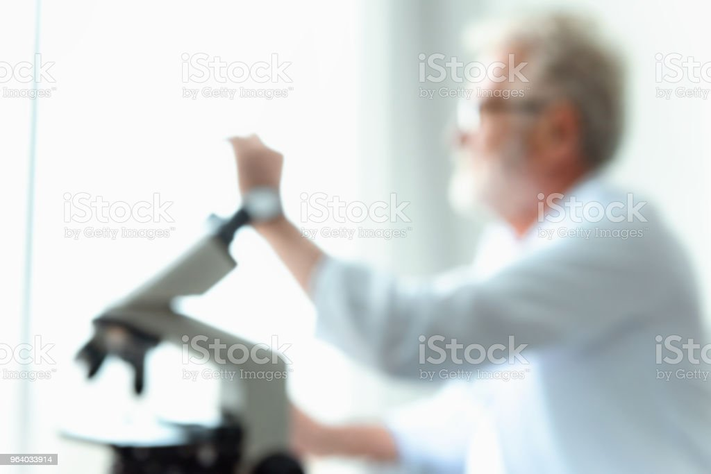 Abstract motion blurred  of senior scientist research using microscope in a laboratory, Biotechnology, Science, Chemistry - Royalty-free Abstract Stock Photo