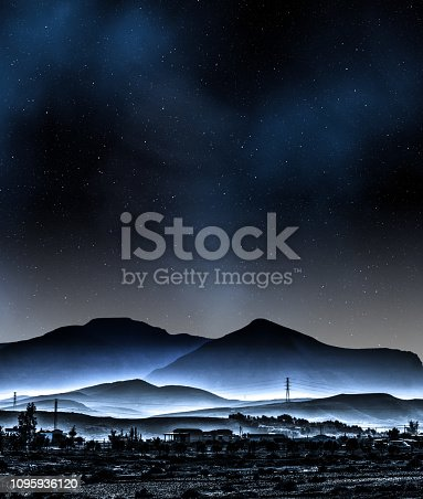 istock Abstract mountain range with fog in fantasy landscape with milky way 1095936120