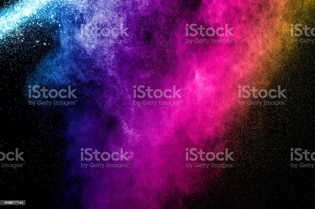 Abstract multi color powder explosion on black background.  Freeze motion of color dust  particles splash. Painted Holi. stock photo