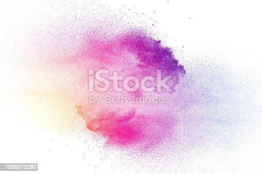 istock Abstract multi color powder explosion on white background.  Freeze motion of  dust  particles splashing. Painted Holi in festival. 1098373280