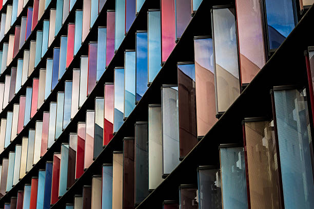abstract multi coloured modern architecture in the city of london - architecture stock photos and pictures