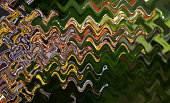 istock Abstract  multicolor zigzag pattern with waves. Artistic image processing created by photo of barberry blooming. Beautiful multicolor pattern in dark tones. Background image 1262614778