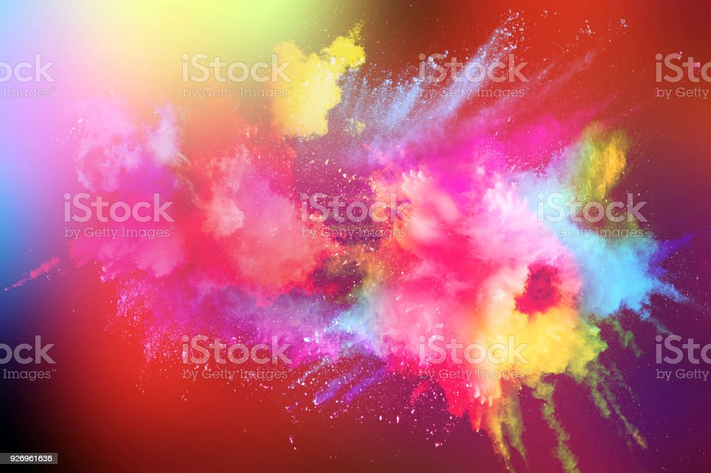 Abstract multicolored powder splatter on white background. stock photo