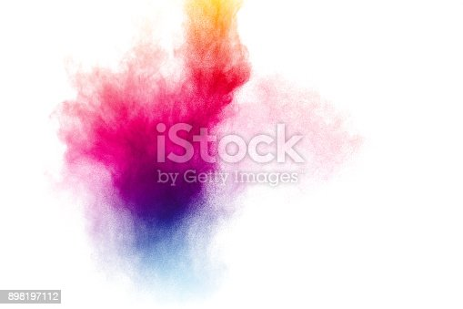 istock abstract multicolored powder splatter on white background,Freeze motion of color powder explosion on white background. 898197112