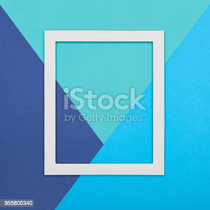 istock Abstract multicoloured paper texture minimalism background. Minimal geometric shapes and lines composition with empty picture frame. 955805340