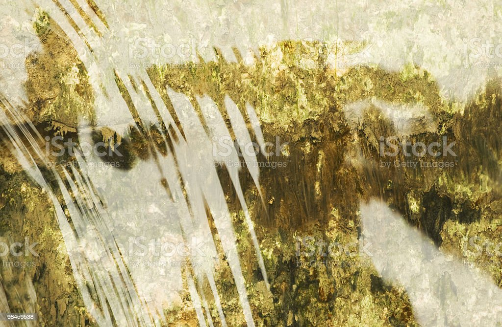 Abstract natural green background of water flow on stone royalty-free stock photo