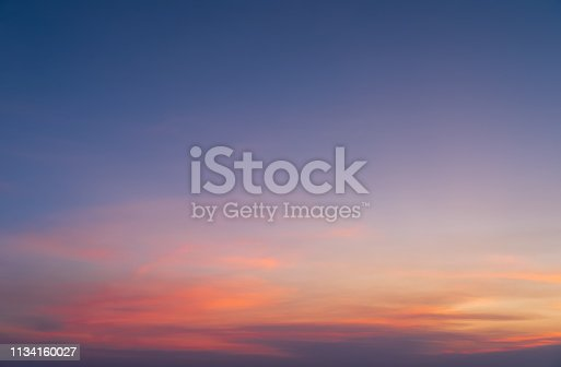 istock Abstract nature background. Dramatic blue sky with orange colorful sunset clouds in twilight time. 1134160027