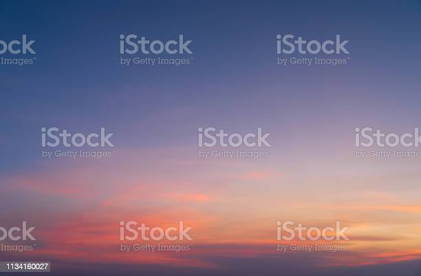Photo of Abstract nature background. Dramatic blue sky with orange colorful sunset clouds in twilight time.