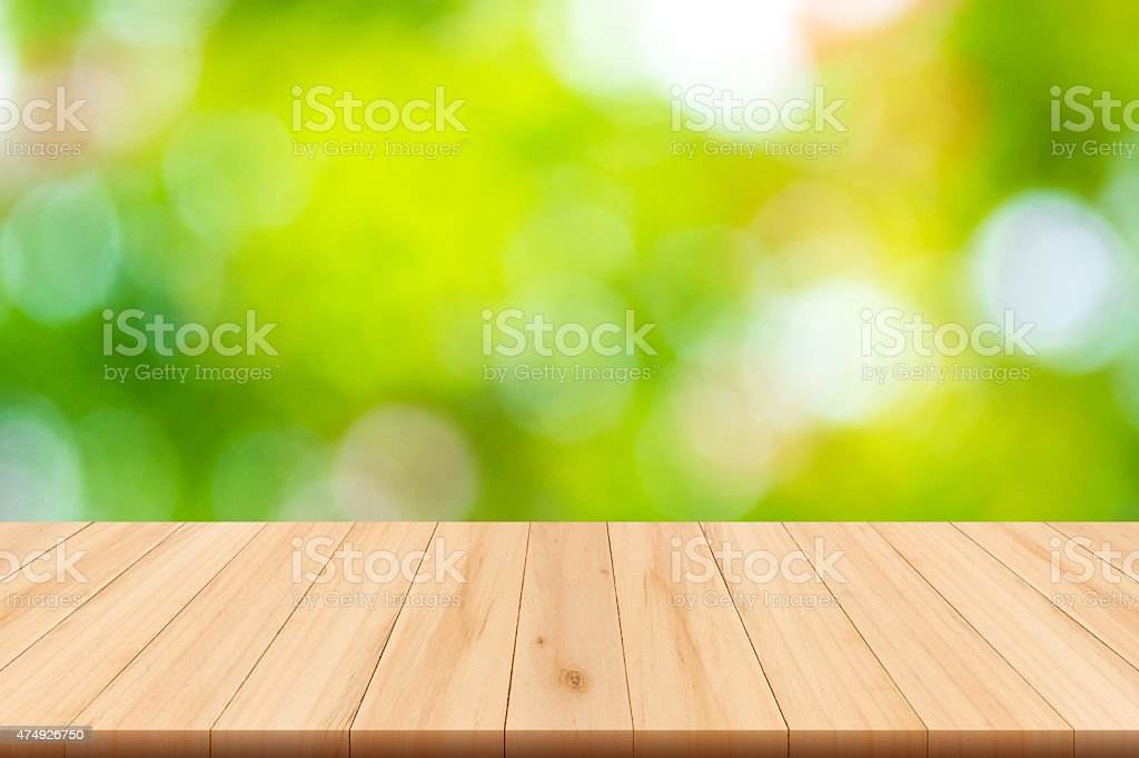 Abstract nature blurred background and wooden floor stock photo