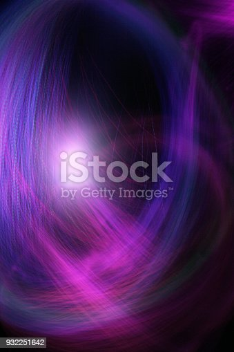 abstract background image with swirling fibre optic streaming light illuminated with darker areas for copy space. The image has a celestial space like science feel and ambiguous scale