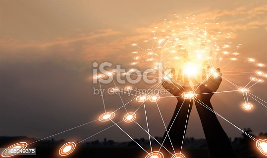 istock Abstract networking. Technology and communication. Hands holding global network and data exchanges on sunset background. 1165049375