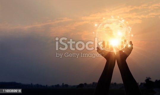 istock Abstract networking. Technology and communication. Hands holding global network and data exchanges on sunset background. 1165069916