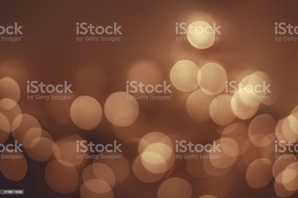 Abstract Night background with gold bokeh lights  and place for stock photo