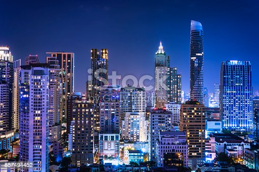 istock abstract night cityscape blue light filter - can use to display or montage on product 887494452