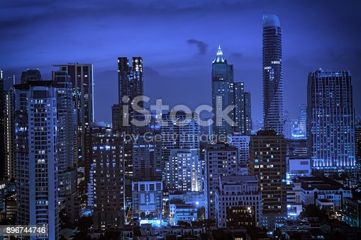 istock abstract night cityscape with light blue filter - can use to display or montage on product 896744746