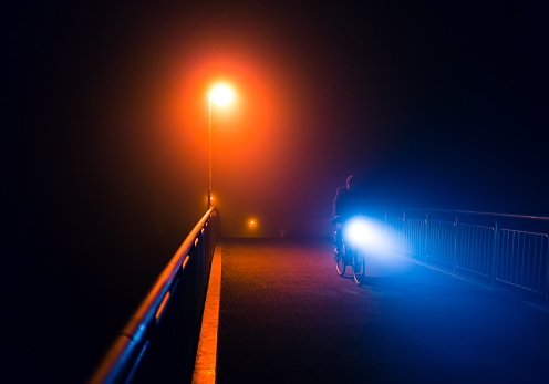 929609038 istock photo Abstract night foggy walk in city park with streetlights 639595638